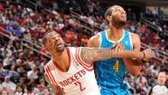 Marcus Morris #2 of the Houston Rockets and Xavier Henry #4 of the New Orleans Hornets fight for the rebound