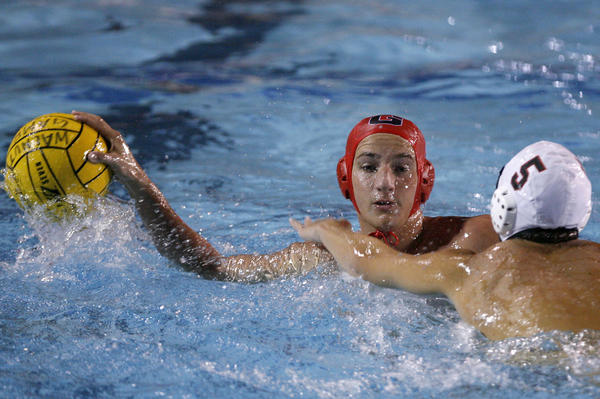Glendale High's #7 Manuk Piloyan keeps theball away from #5 Joseph Dempsey during 2012 CIF SS Div. 5 Boys Water Polo Semi Finals vs. Riverside Poly at Mt. San Antonio College in Walnut on Wednesday, Nov. 14, 2012. Glendale won 14-7 and will play Pasadena Poly in the finals.