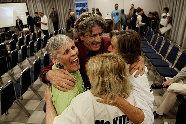 Hunter Kilpatrick, center, of the California Gray Whale Coalition celebrates with Molly Johnson, left, Mandy Davis, right, and Marla Jo Bruton after the California Coastal Commission denied PG&E a permit for offshore seismic tests.
