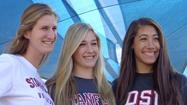 Corona del Mar High girls' volleyball standouts Grace Kennedy (Stanford), Kelsey Humphreys (Stanford) and Alexis Cage (San Diego State) smile during a signing ceremony at CdM.