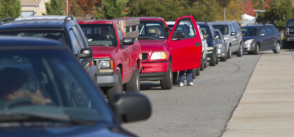 Vehicles from local organizations line up for turkey distribution organizations Wednesday at the Virginia Peninsula Foodbank in Hampton. Approximately 1,100 turkey's were distributed Wednesday, only  a fraction of the ones that are needed by the Foodbank for