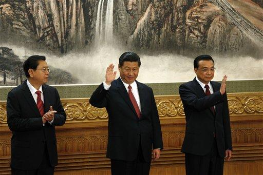 From left, members of the new Politburo Standing Committee Zhang Dejiang, Xi Jinping and Li Keqiang meet journalists in Beijing's Great Hall of the People on Thursday.