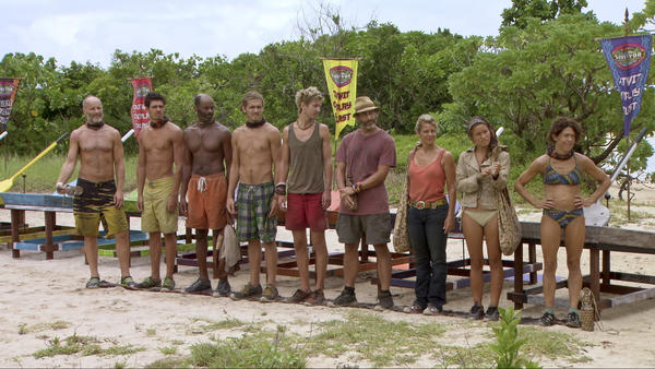 The remaining tribe members gather for their next challenge.