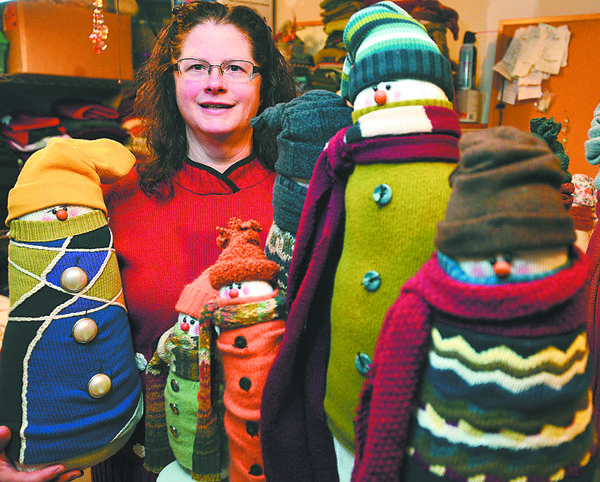 Barbara Wachter of Greencastle, Pa., crafts sweaters into snowmen and will sell them at the 2012 Kris Kringle Holiday Craft Show at Hagerstown Community College.