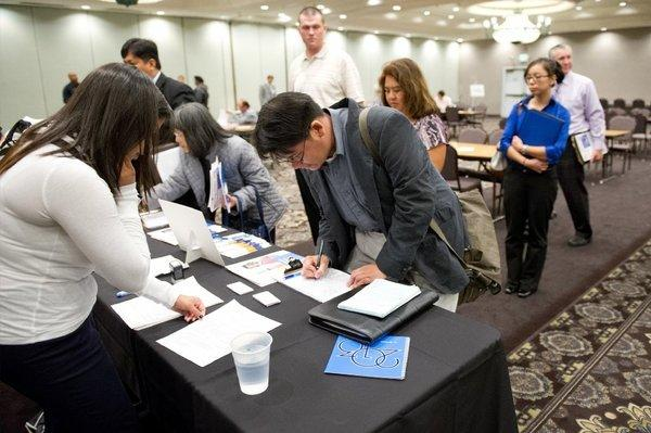 Job applicants fill out applications during a HIREvent job fair in Concord, Calif.