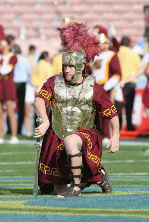 Drum major Ed Carden of USC places a sword in midfield before the game against the UCLA Bruins on Dec. 6, 2008.