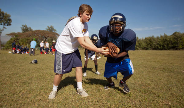 St. Paul's football player Kiefer Rawlings teaches the game to children in Kenya.