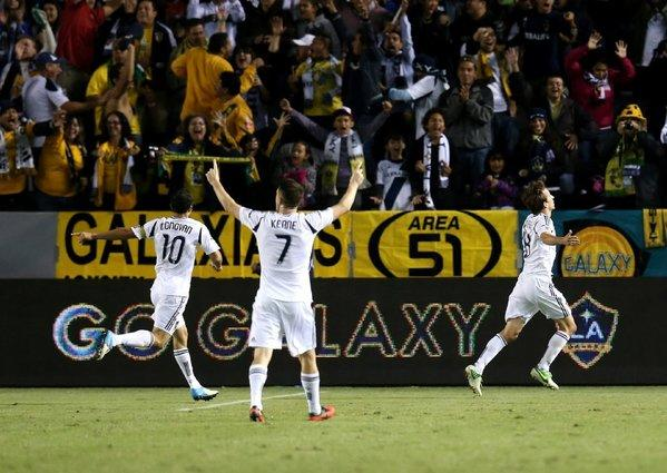 Landon Donovan, Robbie Keane and Mike Magee celebrate after Magee's goal against the Seattle Sounders in Game 1 of the Western Conference championship.