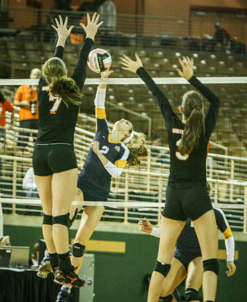 Boca Raton's Haley Little (2) goes up for a kill shot during second set action of their match against Winter Park in a Class 8A FHSAA Girls High School Volleyball State final game at the Silver Spurs Arena in Kissimmee, Fla. on Wednesday, November 14, 2012.