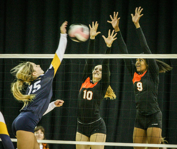 Boca Raton's Charlotte Earnhart (15) hits a kill shot during fifth set action of their match against Winter Park in a Class 8A FHSAA Girls High School Volleyball State final game at the Silver Spurs Arena in Kissimmee, Fla. on Wednesday, November 14, 2012.
