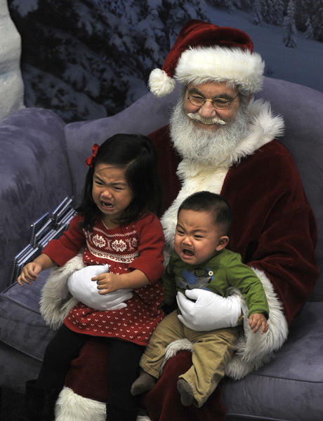 WEST HARTFORD, CT; 11/14/2012: Kayla Lee, 2 1/2 and her brother Gavin Lee, 7 months, are not so sure about sitting with Santa Claus for a picture at the West Farms Mall in West Hartford. The Lees are from Southington.