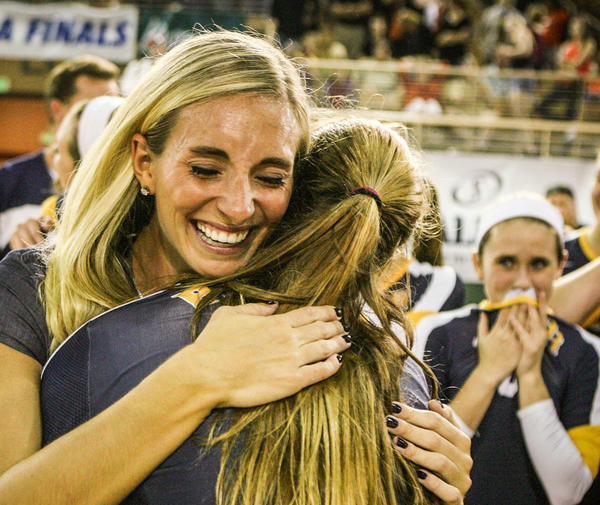 Boca Raton's Ruth Harrington (9) hugs coach Amanda Angermeier after defeating Winter Park in the fifth set of a Class 8A FHSAA Girls High School Volleyball State final game to become State Champions at the Silver Spurs Arena in Kissimmee, Fla. on Wednesday, November 14, 2012.