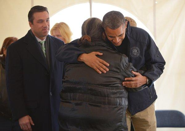 President Obama hugs a woman as he tours a FEMA disaster recovery center on Staten Island on Thursday.