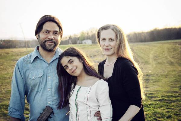 Singer-songwriter Elizabeth Mitchell, right, with her husband, Daniel Littleton, and their daughter, Storey.