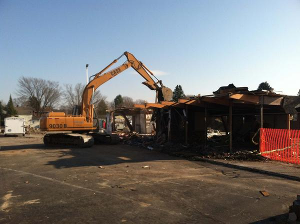 An excavator demolishes the former Hu Nan Chinese Restaurant today at the corner of Spring Street and Charlevoix Avenue in Petoskey. Brian Ludlow, a landowner involved in redeveloping the site, expects a new McDonald's restaurant will be built in Hu Nan's place next spring.