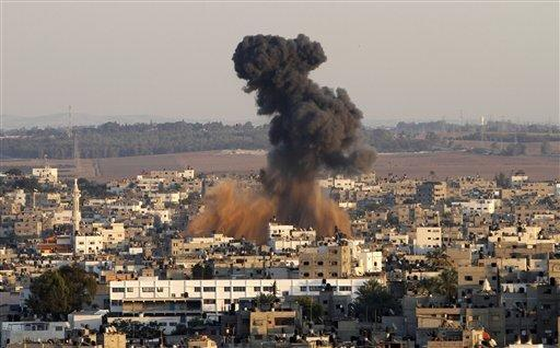 Smoke rises following an Israeli attack on Gaza City on Thursday. Israel barraged the Gaza Strip with airstrikes and shelling Wednesday and killed the Hamas military chief in a targeted strike, launching a campaign aimed at stopping rocket attacks from Islamic militants. The assault killed 10 other Palestinians, including two children and seven militants. On Thursday, militant rockets fired into Israel killed three Israelis, raising the likelihood of a further escalation.