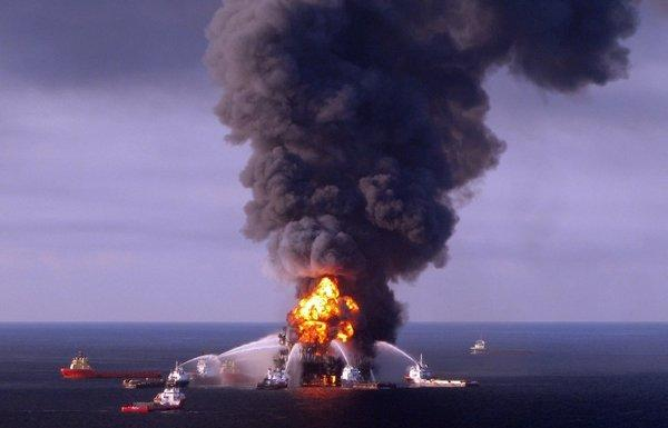 A U.S. Coast Guard handout image of fire boat response crews as they battle the blazing remnants of the BP-operated offshore oil rig, Deepwater Horizon, in the Gulf of Mexico. BP will pay a record criminal penalty to resolve some of its liability for the 2010 Deepwater Horizon disaster that killed 11 workers.
