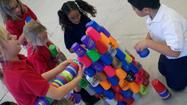 Students attempt to break cup stacking record