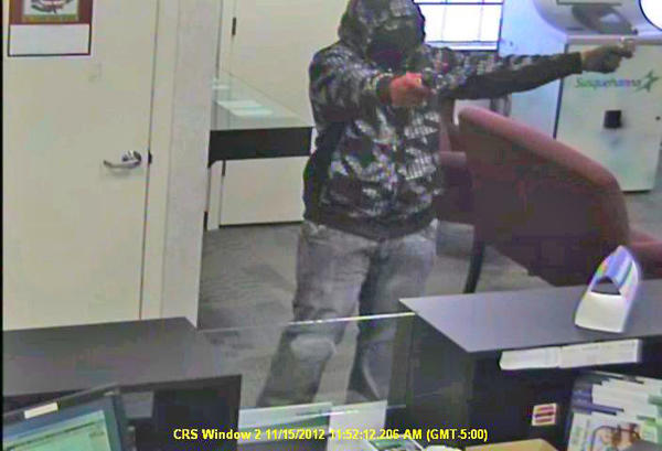 A suspect is caught on surveillance video Thursday during the robbery of Susquehanna Bank at the corner of Salem and Rhode Island avenues.