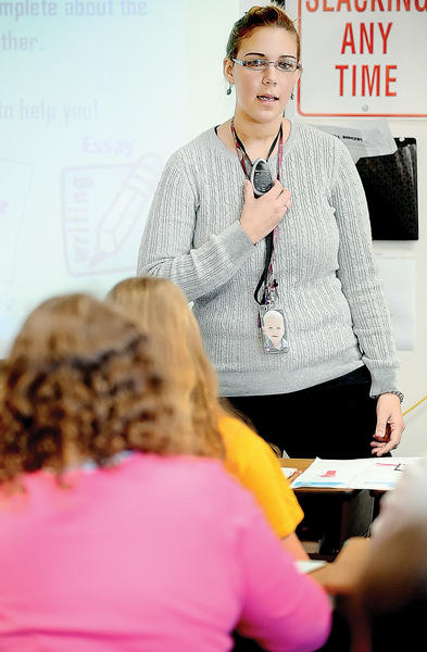 Western Heights Middle School geography teacher Laurie Atwell uses a wireless mic to speak to her class.