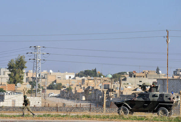 Turkish soldiers patrol in the border town of Ceylanpinar.