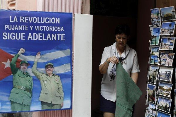 "A poster at a state-owned souvenir shop in Havana depicts Fidel and Raul Castro, in healthier days, vowing that ""The Revolution forcefully and victoriously moves ahead."" A U.S. embargo against Cuba was denounced by the U.N. General Assembly on Tuesday by a vote of 188-3, the 21st consecutive global censure of Washington for its isolationist policy toward the communist-ruled island."