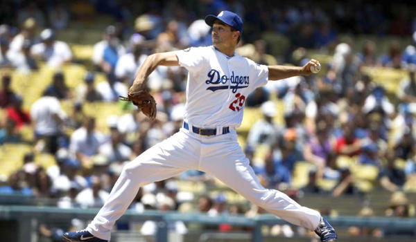 Dodgers pitcher Ted Lilly delivers a pitch against the Padres in the second inning at Dodger Stadium.