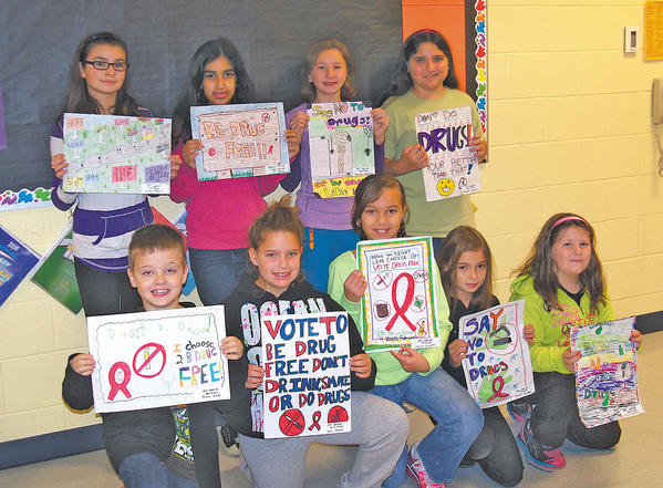 Maugansville student poster contest winners are, top row, from left, Kyra Thomas, Fiza Younus, grand-prize winner, Chelsea McIntosh and Miranda DiNezza. Bottom row, Ryan Wade, Lexi Reed, Jocelyn Hockaday, Sienna Golden and Kylie Deaton.