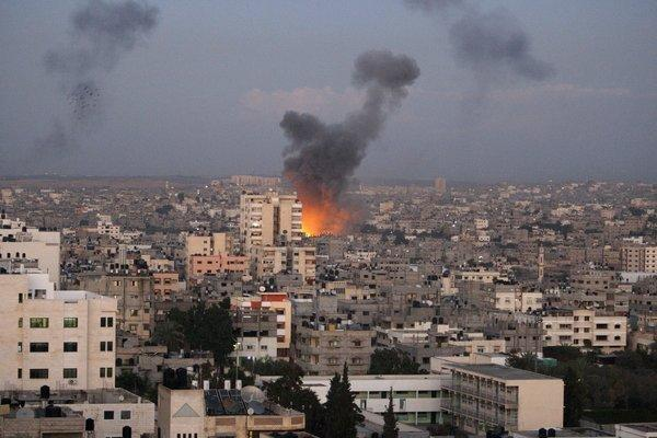 Columns of smoke rise following an Israeli air strike in Gaza City on Wednesday. Palestinian witnesses say Israeli airstrikes have hit a series of targets across Gaza City, shortly after the assassination of the top Hamas commander.