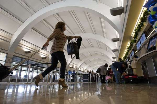 A traveler hurries through John Wayne Airport during last year's Thanksgiving travel period.
