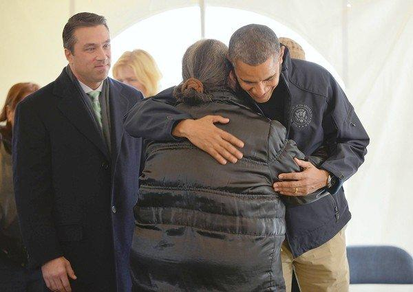 President Obama comforts a woman during a tour of a disaster center on Staten Island in New York.