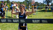 Cross country runner Hannah Oneda hits full stride in a hurry at Johns Hopkins