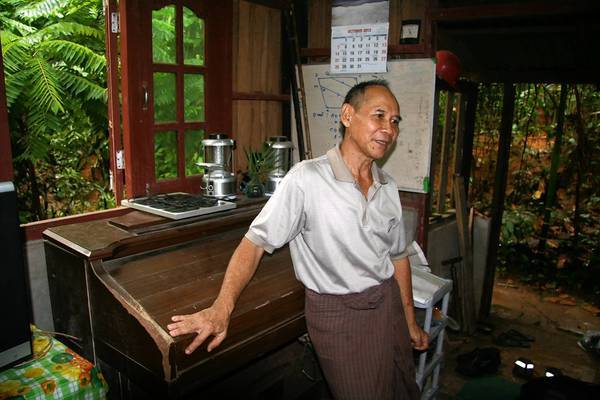 "Saw Simon, one of Aung San Suu Kyi's piano tuners, is shown at home in Yangon with his electric piano. ""I was very afraid; those were very difficult times,"" he said of working on the activist's piano. ""I thought I might get persecuted for helping, but it worked out all right."""