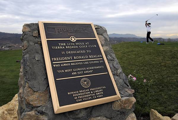 A plaque in honor of former President Reagan is located near the tee box on the 11th hole at the Tierra Rejada Golf Course in Moorpark.