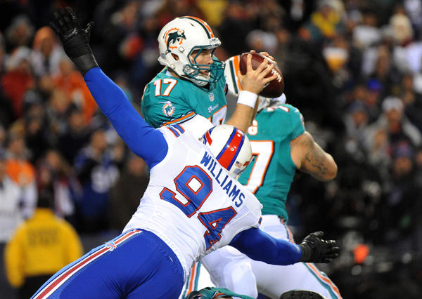 The Bills' Mario Williams gets to Dolphins quarterback Ryan Tannehill for a sack.
