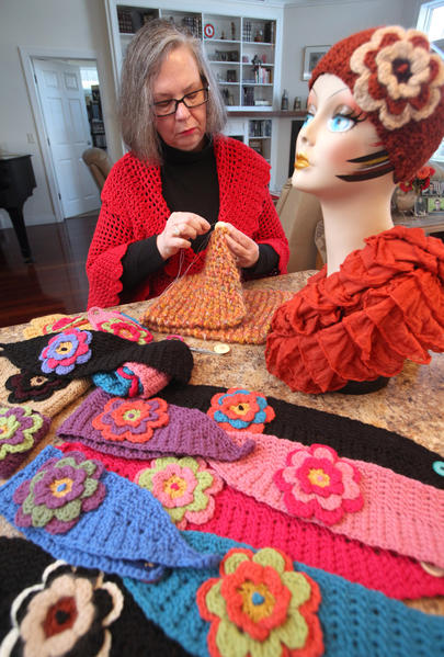 Betty Clay sews a button as she works near some of her headband creations that she will have at her booth at Winterfest this weekend at the Aberdeen Civic Arena. American News Photo by John Davis