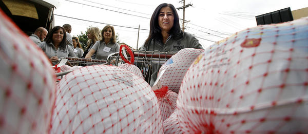 Warner Bros volunteer Florence Anghel (cq) helped unload 60 frozen turkeys for the needy at the Burbank Temporarty Aid Center in Burbank on Thursday, Nov. 15, 2012.  About 20 volunteers from WB, who donated 80 frozen turkeys, helped at the good bank for about three hours.