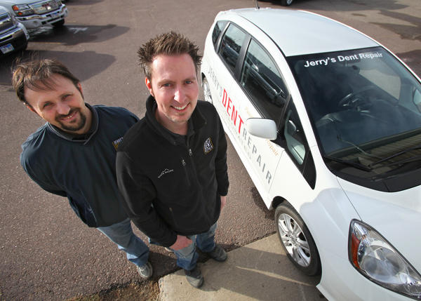 Kellly Schuster, technician, left, and Jerry Dougherty owner of Jerry's Dent Repair, of Aberdeen.