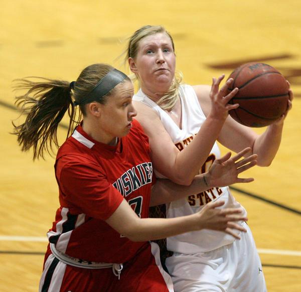 Northern State's Sarah Hintz (with ball) tries to get around St. Cloud State's Sam Price last season.