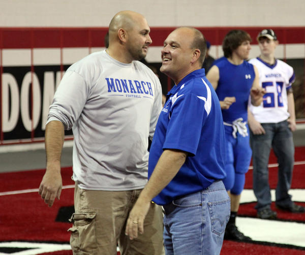 Warner athletic director and dean of students Stew Bohle, right, smiles as he acknowledges Warner assistant football coach Jason Jung at the DakotaDome in Vermillion last week before the Class 9A state championship football game. Bohle is in Mitchell this week following the Warner volleyball team in the State B tournament.