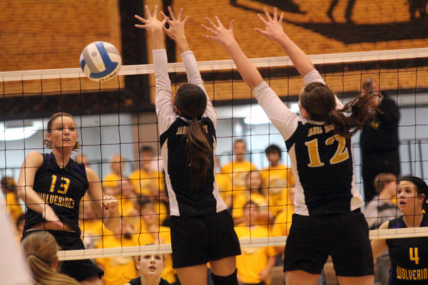 Shauni Schwartz (13) gets a kill for Herreid-Selby Area in the State B Thursday against James Valley Christian.