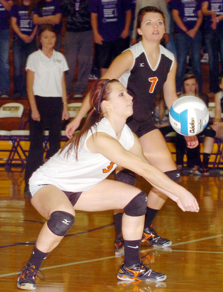 Mobridge-Pollock's libero Maranda Wagner makes a dig while teammate Ellie Rabenberg looks on during their opening-round match against Belle Fourche Thursday afternoon in the state Class A volleyball tournament at Watertown.