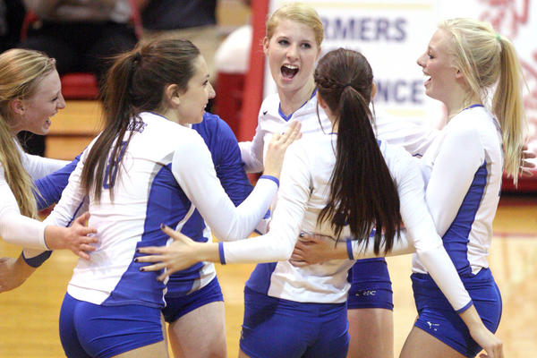 Aberdeen Central celebrates a winning point against Rapid City Stevens during the State AA volleyball tournament in Rapid City Thursday.
