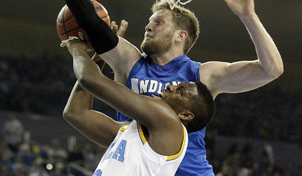 UCLA guard Jordan Adams is fouled going hard to the hoop against Indiana State forward Jake Kitchell.