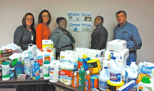 Pictured is the team that collected the most items for the REACH cold weather shelter. From left, Amanda Plank, RN; Ashley Potter, rehabilitation specialist; Ebone Mitchell, licensed clinical professional counselor; Clyde Constant, RN; and Frank Forrest, facility/fleet.