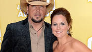 "<span style=""font-size: small;"">Jason Aldean and his wife Jessica Ussery are still united after Jason's photo scandal with American Idol contestant Brittany Kerr. The couple sat beside each other during the CBS This Morning show, (<a href=""http://www.theboot.com/2012/11/15/jason-aldean-cbs-this-morning/"">see video here</a>) where Jason said, ""I think we're fine, you know? I think anytime you go through anything like that, it's tough. We've been together for a long time and been through a lot of things together."" The two are high school sweethearts and have been married for 11 years. Jason adds, ""Those are things that most people get to deal with in private, we didn't have the luxury of doing that."" The singer also compared their relationship to other long lasting pairs. He said, ""Go ask any couple that's been married 30, 40, 50 years…I can guarantee it hadn't always been roses."" Jessica chimed in, ""I would love to hear their story."" The couple has two children together – Keeley, 9, and Kendyl, 5.</span>"