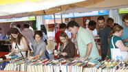 It's not even the weekend, and the Miami Book Fair International has so far delivered a who's who of celebrated authors in Tom Wolfe, Junot Diaz, Sandra Cisneros and others. Literary giants though they are, consider them a palate cleanser to what really draws the glut of book lovers to downtown Miami: The weeklong fair's most-popular and best-recognized feature, the open-air sprawl of booksellers and music known as the Street Fair.