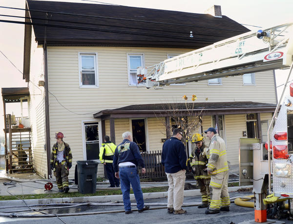 A ladder from a Williamsport Volunteer Fire Co. truck extends to the second floor of a duplex at 42 W. Potomac St. in Williamsport on Friday morning. No one was injured in the fire.