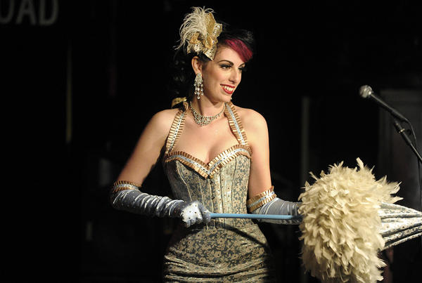 Aurora Natrix of Shameless Burlesque performs during a benefit aimed at helping Liza Toledo acquire a diabetic alert dog.  The burlesque-themed fundraiser was held at Tobacco-Road, Saturday, March 25, 2012, in Miami.
