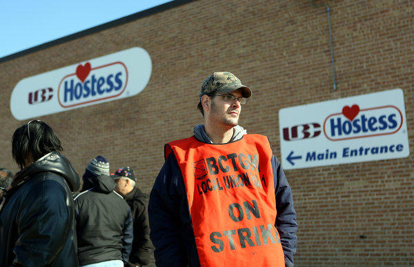 Chris Pruitt, an employee of a Hostess plant in Peoria, strikes with other employees in front of the Hostess Brands plant in Schiller Park.